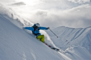 Carving The Mountainside, Last Frontier Heliskiing photo