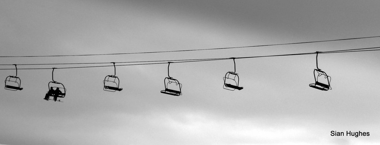Snowboards on chairlift, Morzine