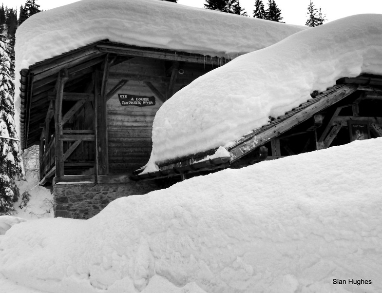 Snow covered chalets in Ardent
