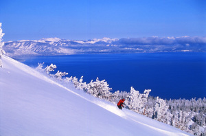 Skiing Heavenly with Lake Tahoe in the backdrop photo