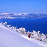 Skiing Heavenly with Lake Tahoe in the backdrop, USA - California