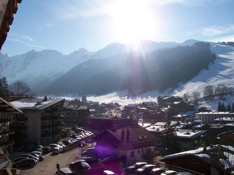 Beautiful sight over the village on the runs with sun, La Clusaz