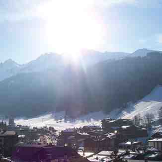 Beautiful sight over the village on the runs with sun, La Clusaz