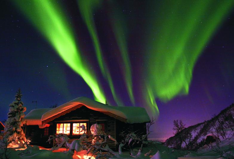 Norway Aurora Borealis over cabin, Voss