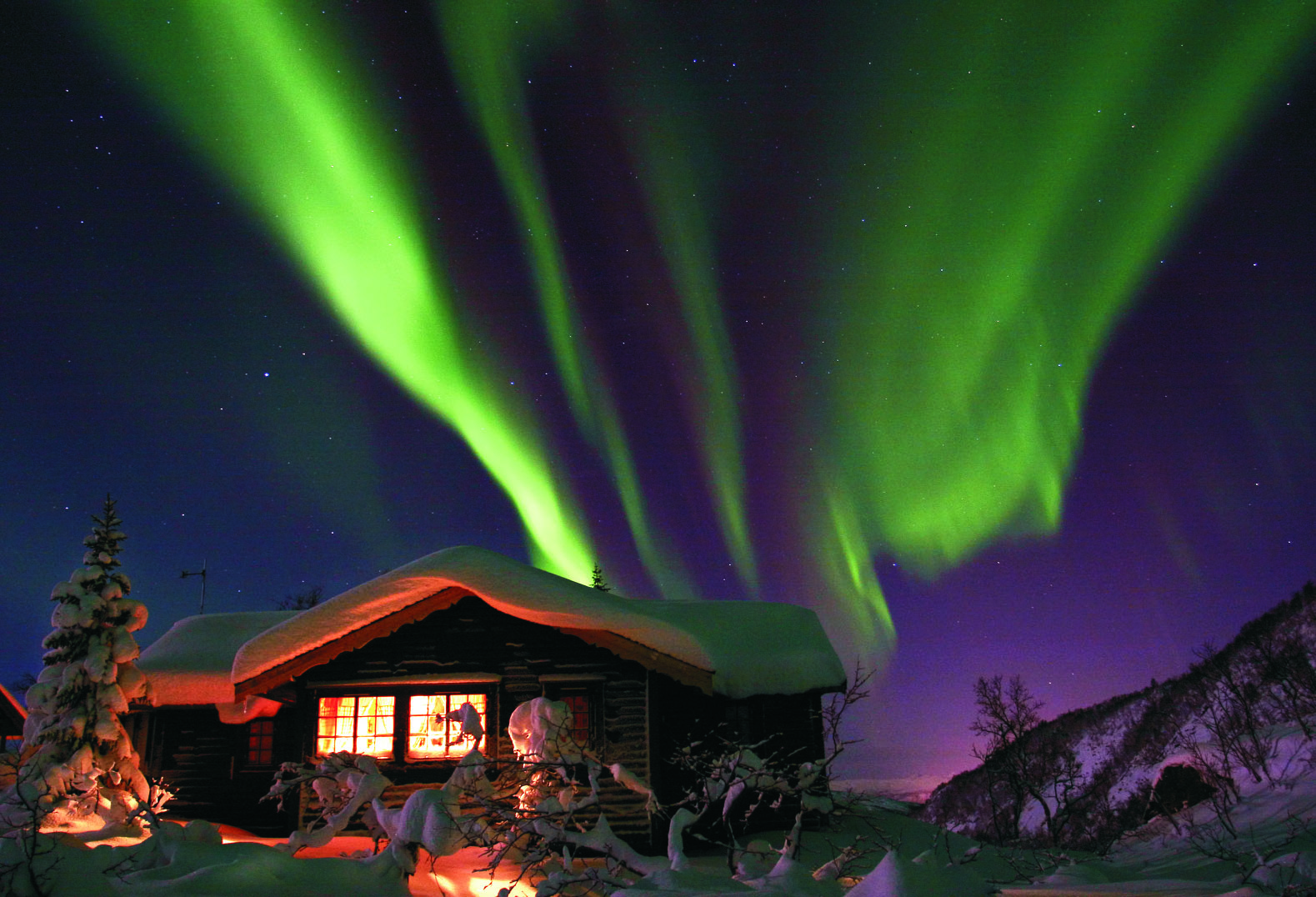 Norway Aurora Borealis over cabin, Voss
