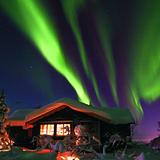 Norway Aurora Borealis over cabin, Norway