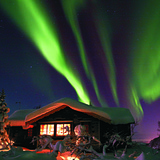 Norway Aurora Borealis over cabin, Norway