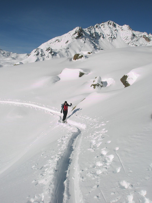Caroline walking to the Shlippin pass into Austria from Madrisa above Klosters, Davos