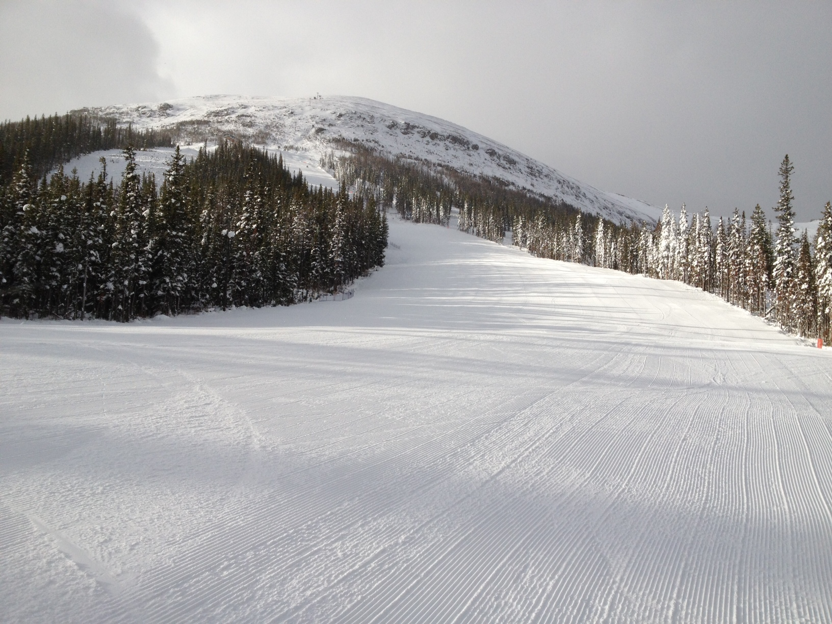 Mapmaker looking up to gold Chair, Nakiska