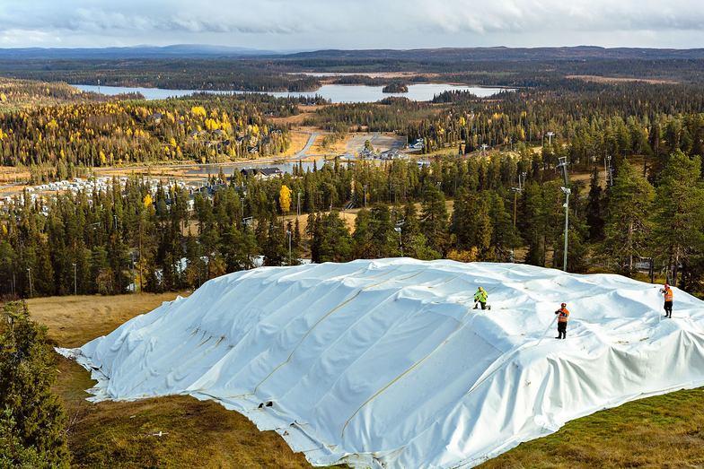 Last season's snow stored under cover at Ruka