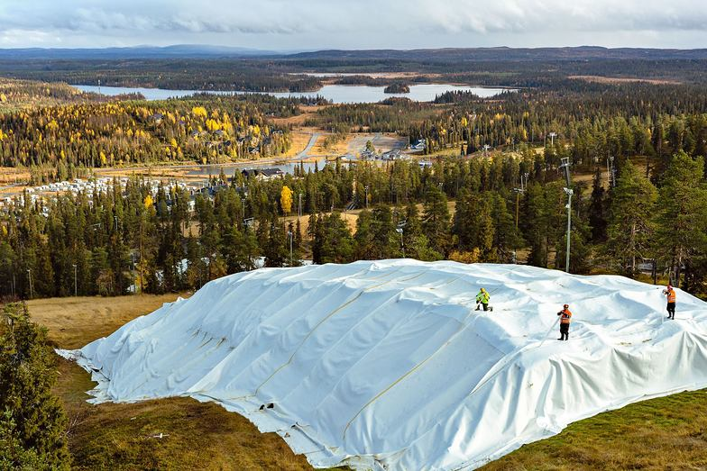 Last season's snow stored under cover at Ruka