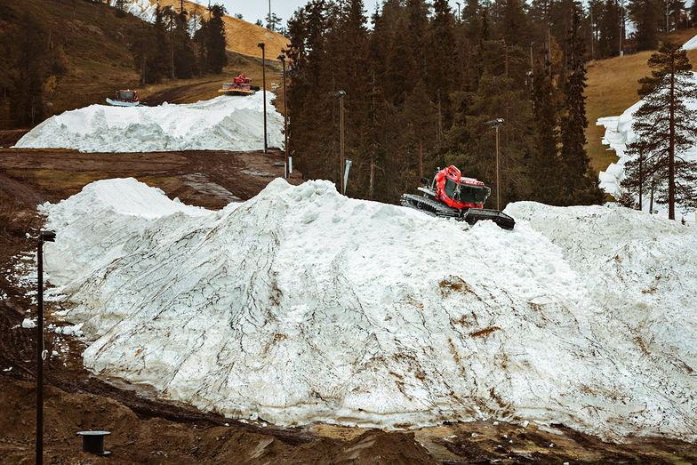Spreading out last winter's snow ahead of October opening at Ruka