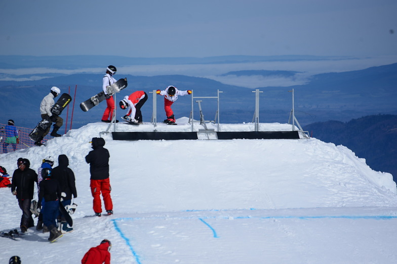 We are training, full snow, ready tracks, athletes from China National Snowboard Team supervised by China Water Sports Administration Center, prepare for next Olimpics Games, Beijing 2022, Villarrica-Pucon
