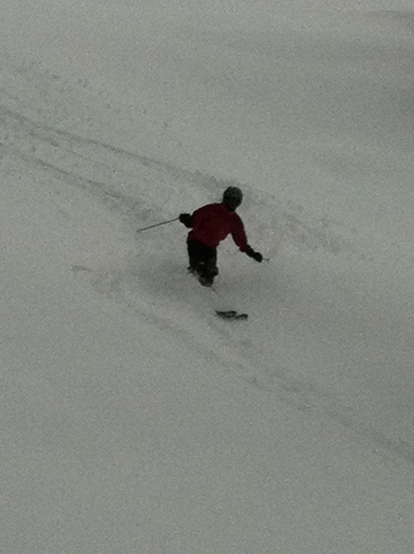Gabby shanahan making perfect tracts in the gully above Obersaas, Davos